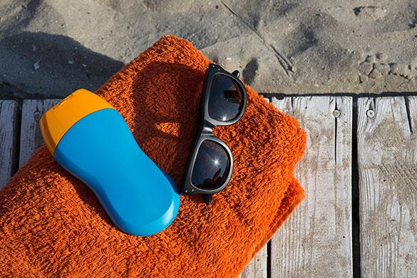 sunscreen-towel-sunglasses